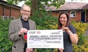Tony Ashman cheque presentation at Brundall Medical Centret